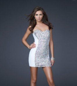 """available at www.dzinecouture.co.za""""This stylish strapless cocktail dress is made of ruched netted fabric with a jewel encrusted front for an uber sassy look."""""""