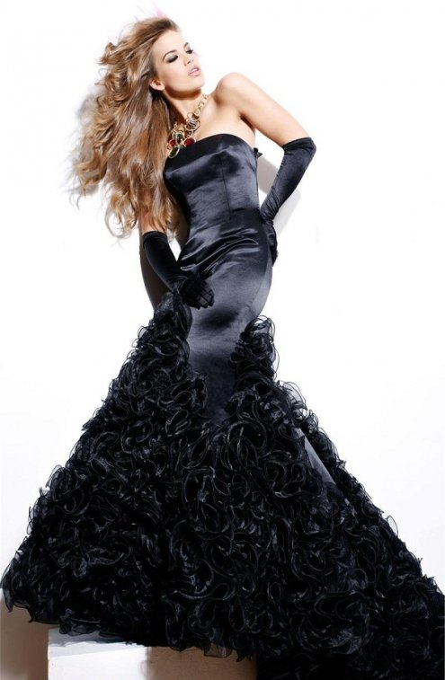 """available at www.dzinecouture.co.za""""The elegance and suave of this strapless evening gown is in a league of its own. The shape and form of this glamorous design features a fitted silhouette and full lower skirt with rosette detailing. Accessorise this dress with straight black gloves and a rhinestone bracelet for a polished look."""""""