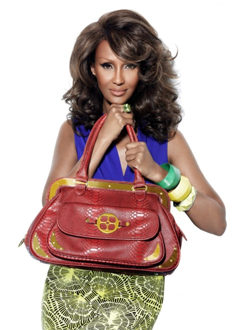 Iman models an Arm Candy bag from her Global Chic line
